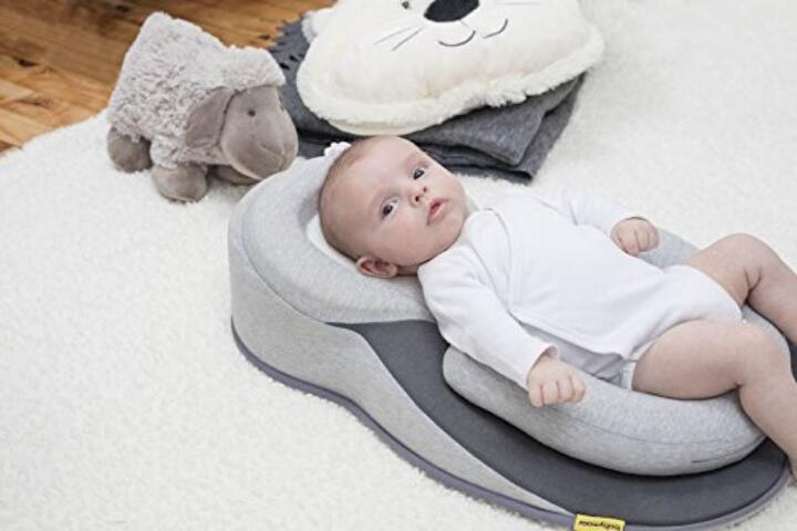 Supporto ergonomico per neonati per la posizione dorsale