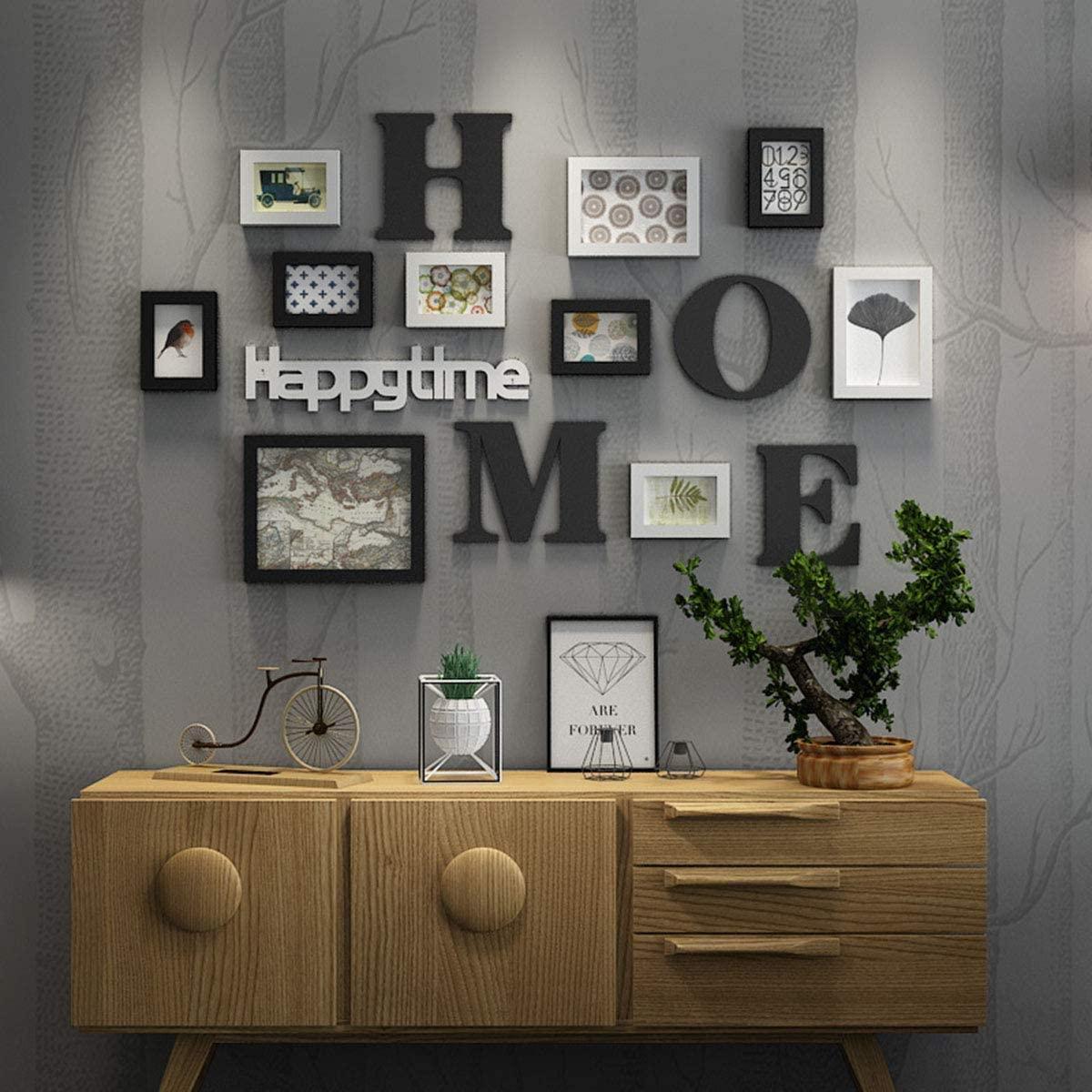 Pareti Con Cornici Diverse come decorare le pareti con le foto di tutta la famiglia